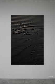 The-surface-of-black-water-s